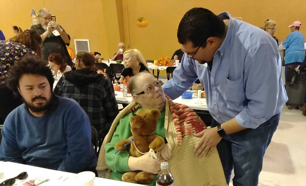 Selwyn Harris/Pahrump Valley Times Nye County District 4 Commissioner-elect Leo Blundo offers a gift of comfort and warmth during Thursday's Thanksgiving Day dinner at the coalition's activities c ...