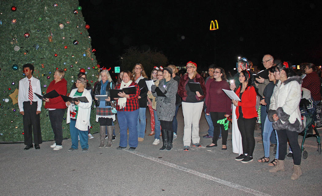 Robin Hebrock/Pahrump Valley Times Members of the High Desert Chorale and the Pahrump Valley High School Choir serenaded the attendees of the Community Christmas Tree Lighting ceremony.