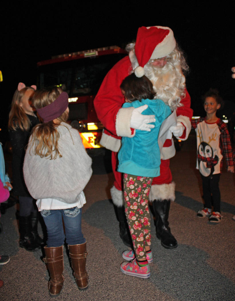 Robin Hebrock/Pahrump Valley Times Santa Claus was embraced by dozens and dozens of valley youngsters when he made his appearance at the Community Christmas Tree Lighting.