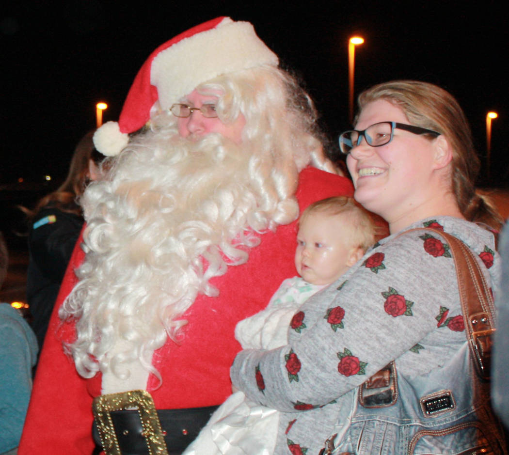 Robin Hebrock/Pahrump Valley Times Saint Nick spent much his time the night of Nov. 24 posing for photographs with the hundreds of residents who turned out to watch the lighting of the Community C ...