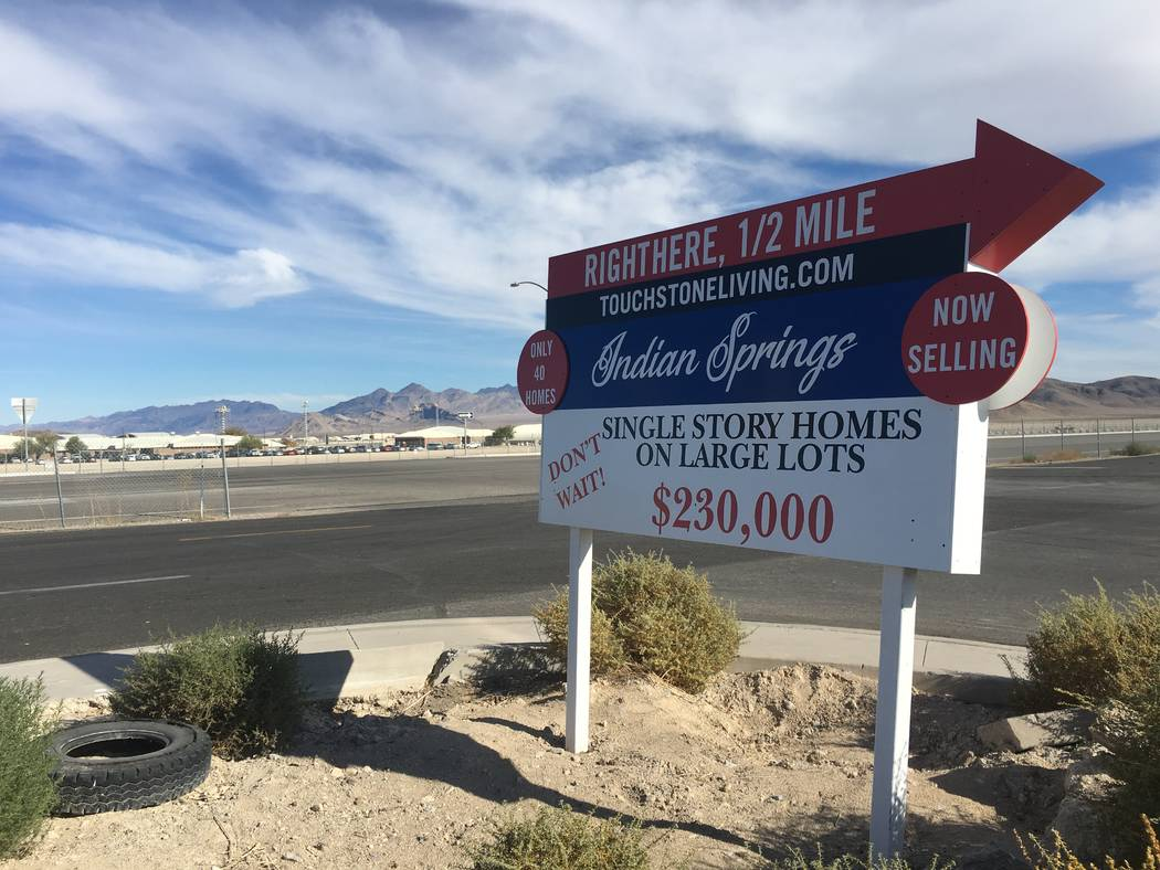 A sign for homebuilder Touchstone Living's project in Indian Springs is seen Tuesday, Nov. 20, 2018, across the highway from Creech Air Force Base. (Eli Segall/Las Vegas Review-Journal)
