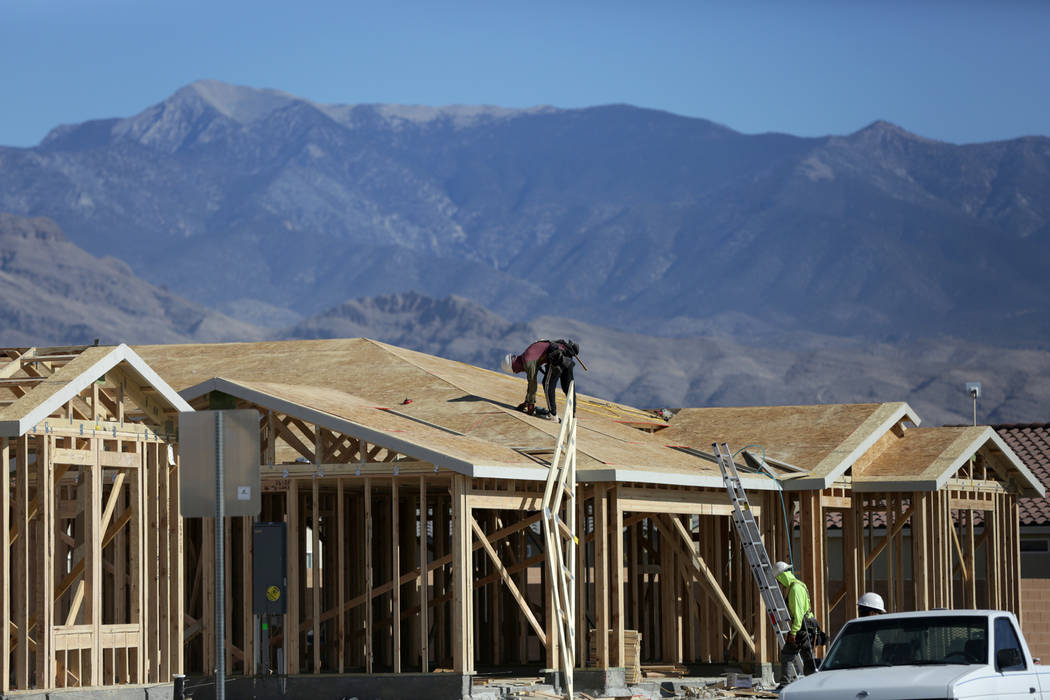 Construction crews work to complete homes Thursday, Nov. 15, 2018, at Burson Ranch in Pahrump, where developers have restarted the rural housing project. Michael Quine/Las Vegas Review-Journal.com ...