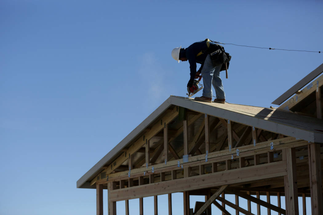 Construction worker finishes up the rooftop on a new home at Burson Ranch in Pahrump where developers have restarted a rural housing project. Thursday, November 15, 2018, . Michael Quine/Las Vegas ...