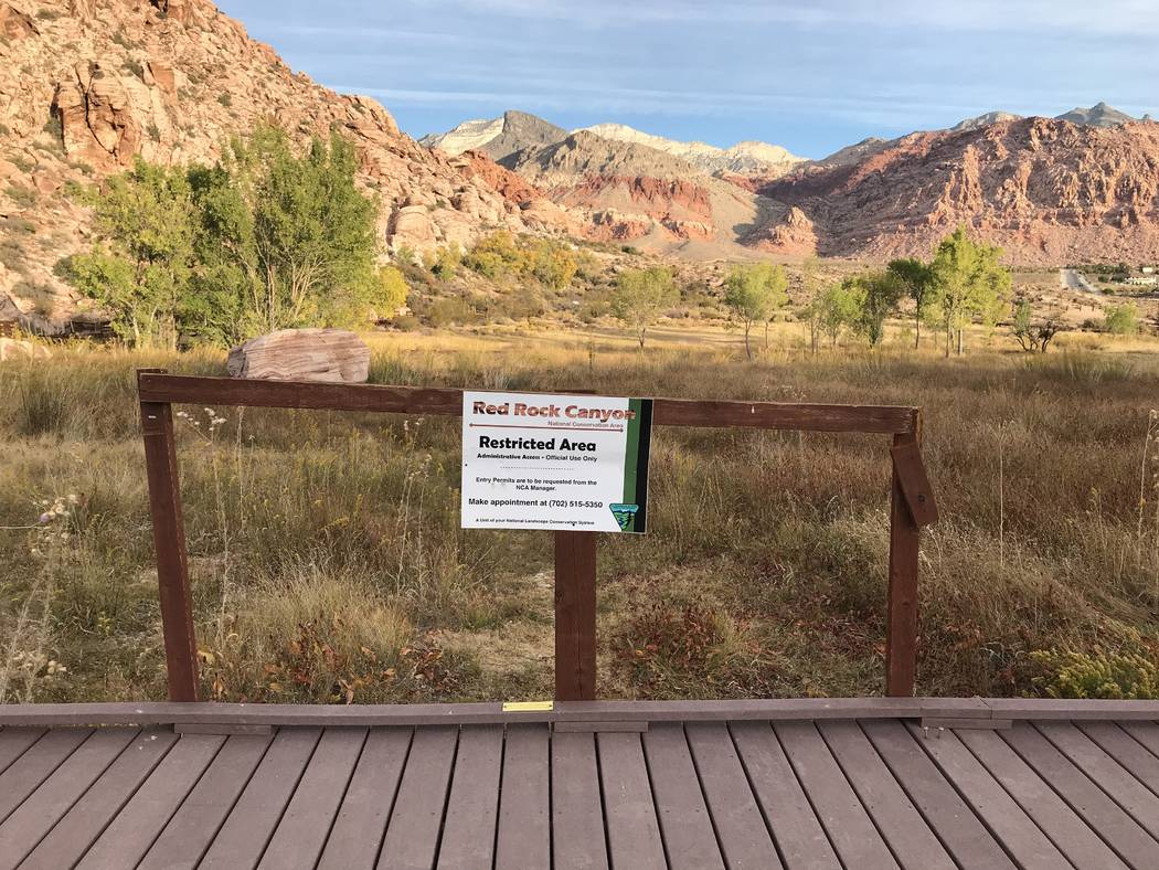 A sign warns visitors about the closure of the Red Spring boardwalk at Red Rock Canyon National Conservation Area on Oct. 29. (Henry Brean/Las Vegas Review-Journal)