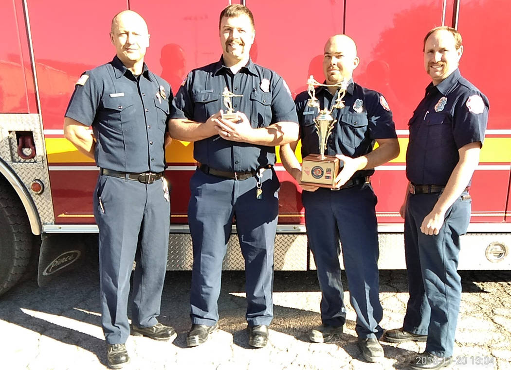 Selwyn Harris/Pahrump Valley Times From left, Pahrump Valley Fire and Rescue Services firefighters James Woodard, Jared Orum, James Rosen and Kurt Overall took home top honors, by pulling a fully ...