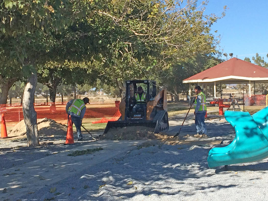 Robin Hebrock/Pahrump Valley Times Workers are pictured laboring at Ian Deutch Memorial Park, where the playground was closed from Nov. 13 to Nov. 28. The prep work was performed to ready the park ...