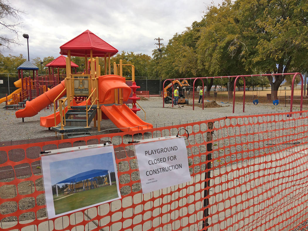 Robin Hebrock/Pahrump Valley Times The playground at Petrack Park is currently closed while work crews, pictured in the background, install foundations for new shade structures.