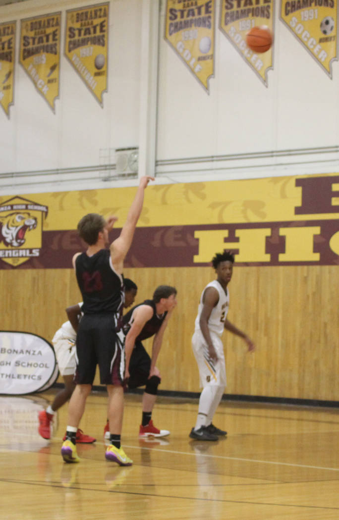 Tom Rysinski/Pahrump Valley Times Senior forward Brayden Severt launches a free throw for one of his team-high 13 points during Pahrump Valley's season-opening loss Tuesday night at Bonanza.