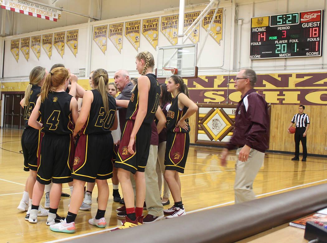Tom Rysinski/Pahrump Valley Times The Pahrump Valley girls basketball team listens to coach Bob Hopkins during a third-quarter timeout Tuesday night against Bonanza in Las Vegas.