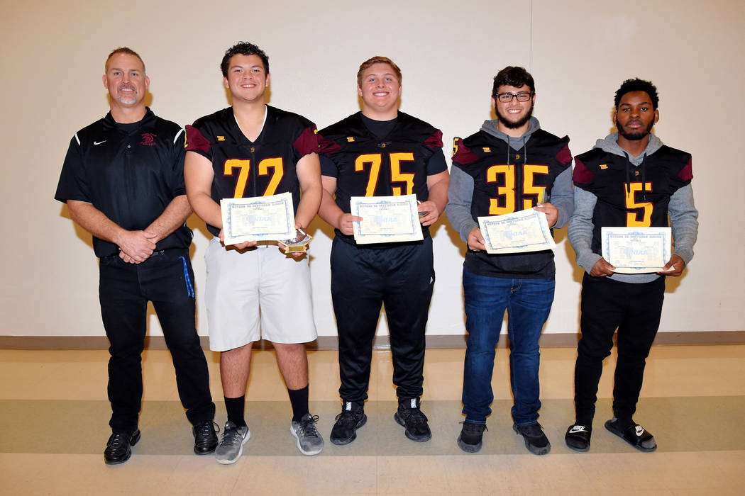 Peter Davis/Special to the Pahrump Valley Times Pahrump Valley's All-Class 3A Southern Region football honorees, from left, Coach of the Year Joe Clayton, first-team offensive lineman Caleb Sproul ...