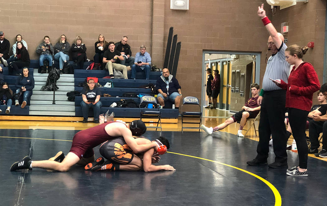 Tom Rysinski/Pahrump Valley Times The referee signals two points for a takedown for Pahrump Valley sophomore Dylan Wright during the Trojans' fifth-place match against Chaparral on Saturday at the ...