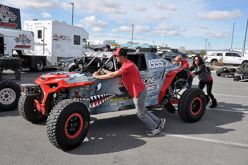 Horace Langford Jr./Pahrump Valley Times Kaden Wells of St. George, Utah, and crew members push his vehicle through the line for technical inspections before the Pahrump Nugget 250 on Kaden Wells ...