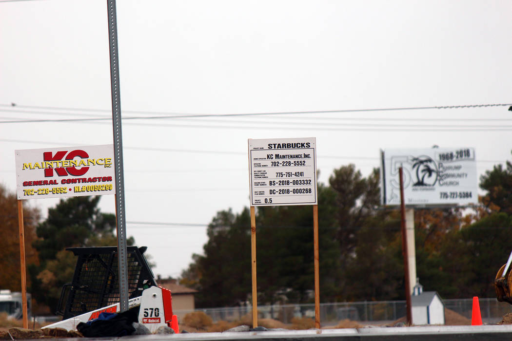 Jeffrey Meehan/Pahrump Valley Times Construction crews work at 460 S. Highway 160 in Pahrump on a new Starbucks location. The general contractor listed on signage is Las Vegas-based KC Maintenance ...