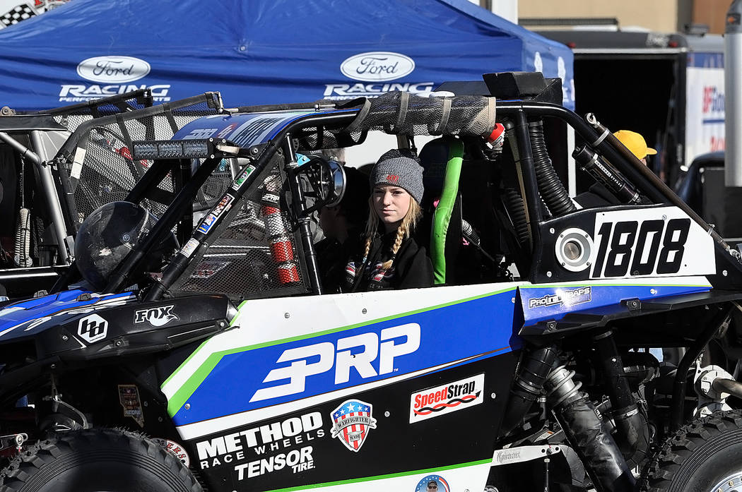 Horace Langford Jr./Pahrump Valley Times Madeline Wedeking of Temecula, California, in her P Class UTV, sits among dozens of drivers waiting for technical inspection Friday in the parking lot of t ...