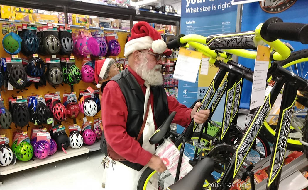 """Selwyn Harris/Pahrump Valley Times A brand new bicycle is a gift every child looks forward to on Christmas morning. Fred """"Santa"""" Summers made sure to note that no video games were purchased as he ..."""