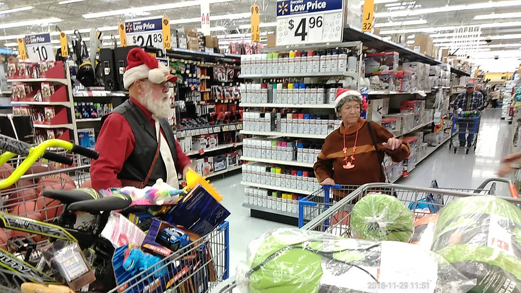 Selwyn Harris/Pahrump Valley Times Fred Summers and his wife Patty fill their shopping carts with a variety of toys during their Christmas shopping excursion at Walmart late last month.