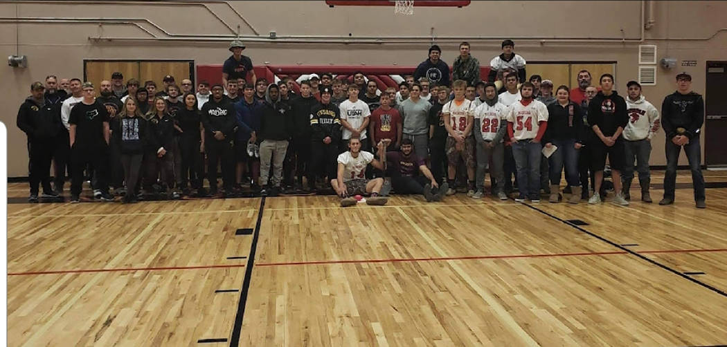 Steve Stringer/Special to the Pahrump Valley Times The Pahrump Valley High School and Tonopah High School football teams pose for a group photo in Tonopah on Nov. 9.