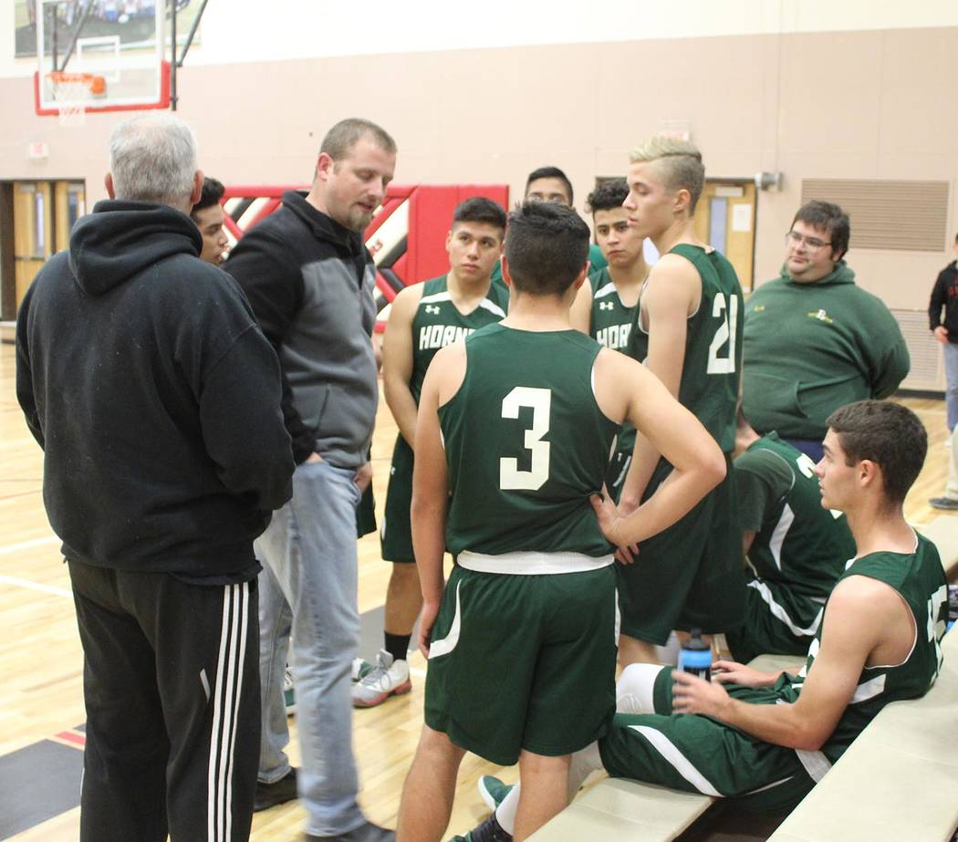 Tom Rysinski/Pahrump Valley Times Beatty coach Steve Sullivan talks to his team during a timeout Tuesday night in Tonopah. Despite 26 points from Alan Sandoval (3), the Muckers defeated the Hornet ...