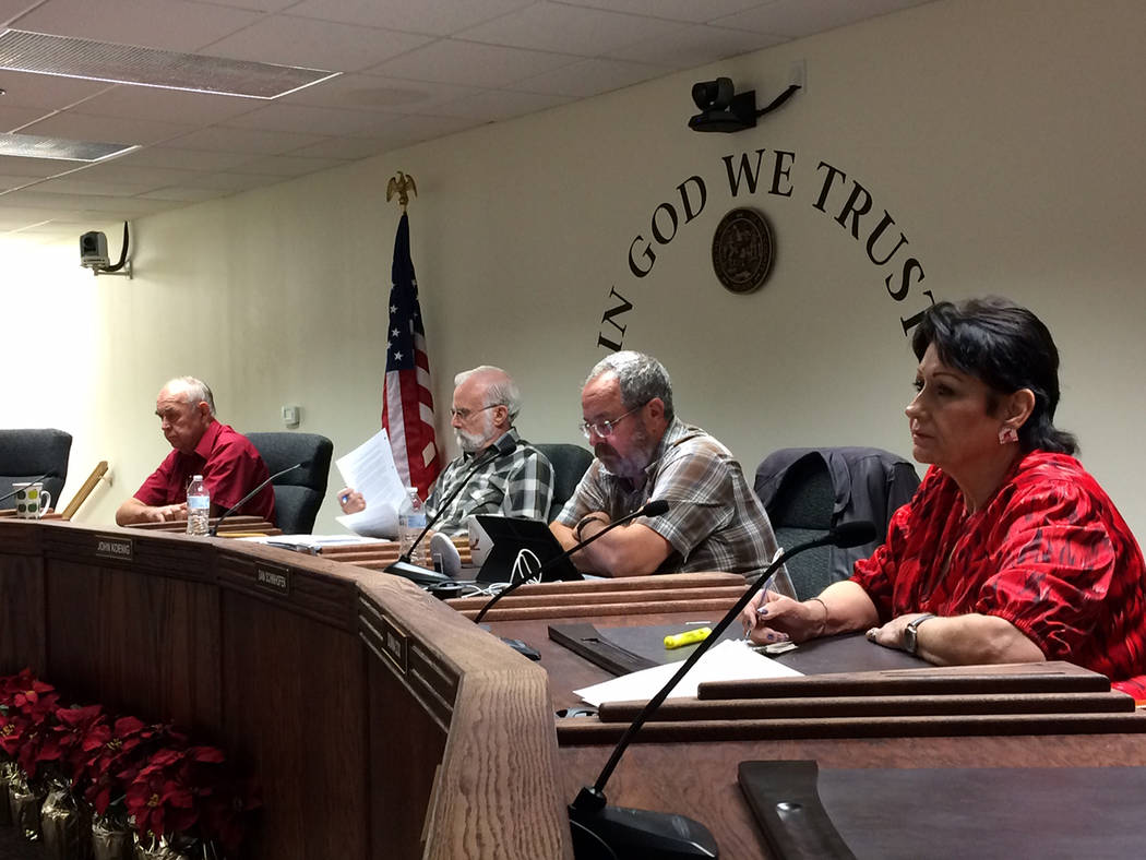 Robin Hebrock/Pahrump Valley Times Shown from left to right are Nye County Commissioners Butch Borasky, John Koenig, Dan Schinhofen and Donna Cox attending the board's Dec. 5 meeting. Commissioner ...