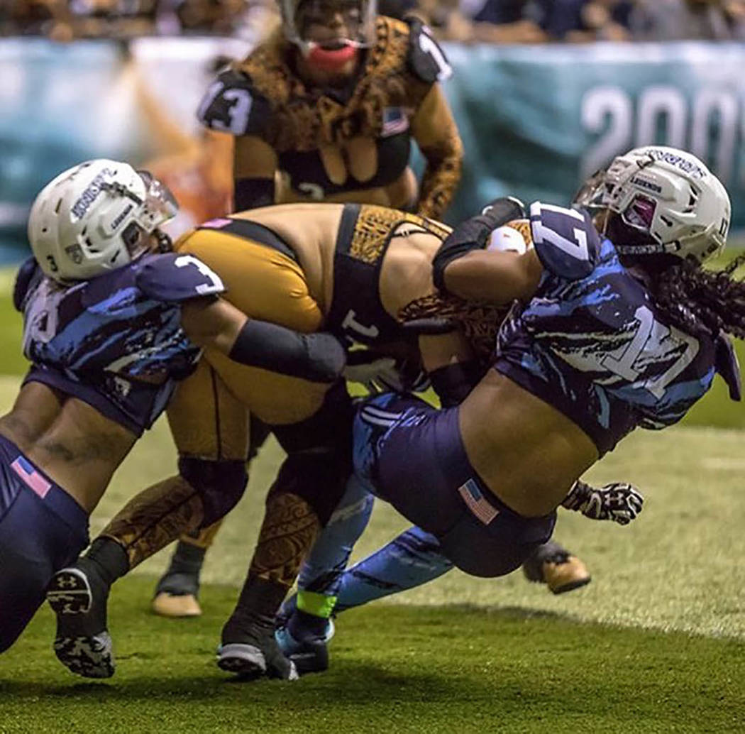 Beard Force Films-Nashville Knights Pahrump Valley High School graduate Dominique Maloy, left, combines with teammate Nene Gleaves to make a tackle for the Nashville Knights during a Legends Footb ...