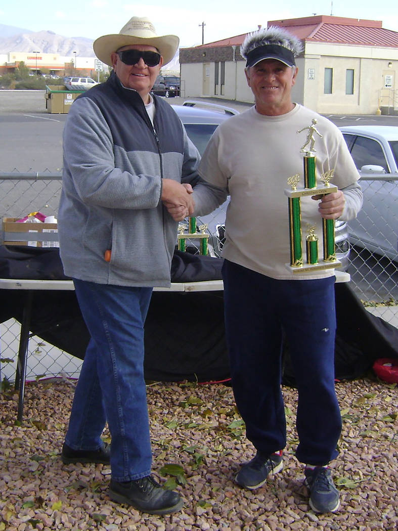 Mike Norton/Special to the Pahrump Valley Times Mike Nicosia accepts the B Division trophy from tournament host Dennis Anderson after last year's Christmas Open horseshoes tournament at Petrack Pa ...