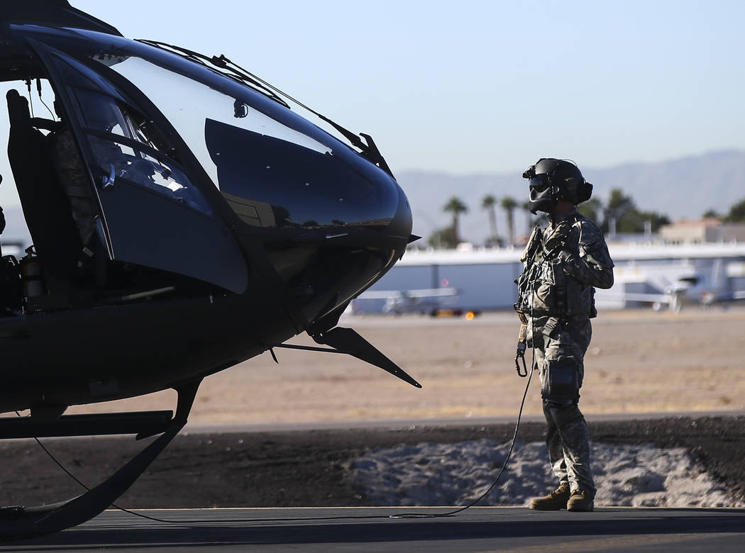Members of the Nevada Army Guard prepare to demonstrate a hoist mission from a UH-72 Lakota helicopter at the support facility by the North Las Vegas Airport in Las Vegas on Friday, Oct. 19, 2018. ...