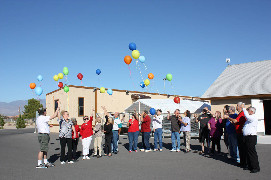 Special to the Pahrump Valley Times Taken in November, 2016, this photo shows a group of GriefShare members celebrating the final meeting of the course with a balloon release. Over a 13-week serie ...
