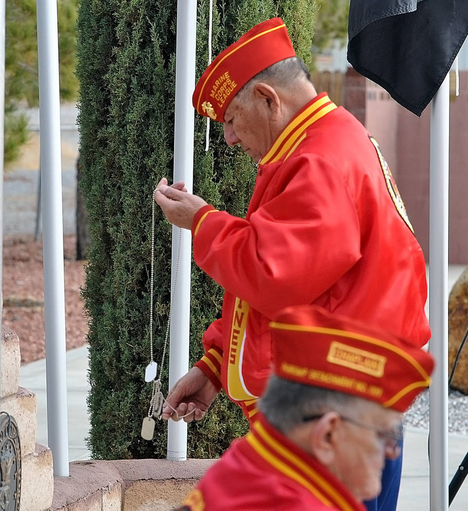 Horace Langford Jr./Pahrump Valley Times Marine Corps Veteran Jose Tellas performs the special dog tag placement at the Veterans Memorial wall