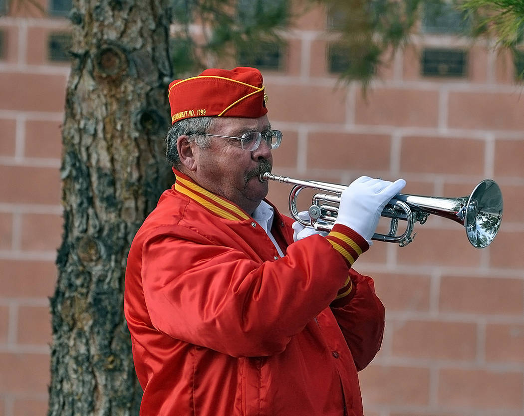Horace Langford Jr./Pahrump Valley Times Pahrump Marine Corps League Detachment 1199 member and Veteran Burt Gigoux plays taps towards the end of the Pearl Harbor remembrance ceremony.