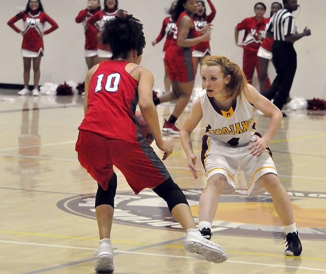 Horace Langford Jr./Pahrump Valley Times Pahrump Valley's Makayla Gent focuses on defending Valley senior Layla Jacksonj during the Trojans' Sunset League-opening victory over the Vikings on Tuesd ...