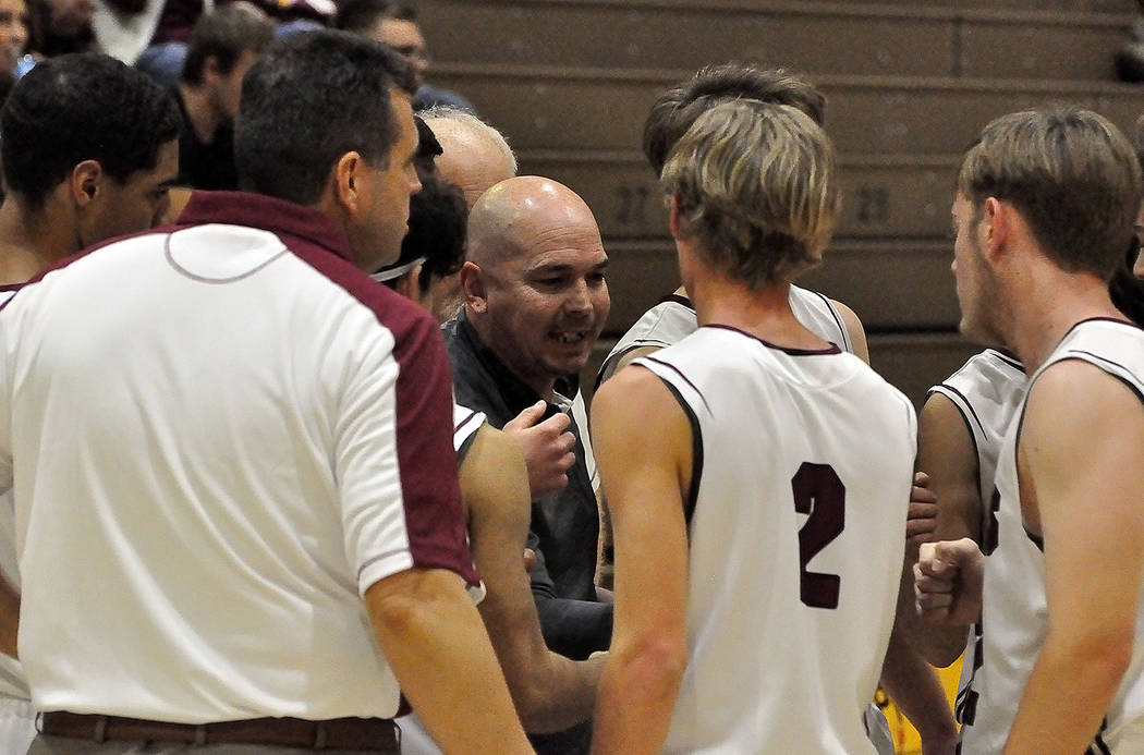 Horace Langford Jr./Pahrump Valley Times Pahrump Valley boys basketball coach Dan Clift talks to his players during a timeout Tuesday night during a 48-41 loss to Valley in the Trojans' Sunset Lea ...