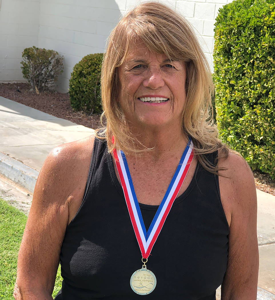 Tom Rysinski/Pahrump Valley Times Cathy Behrens of Pahrump sporting the gold medal she won in the 2017 Nevada Senior Games.