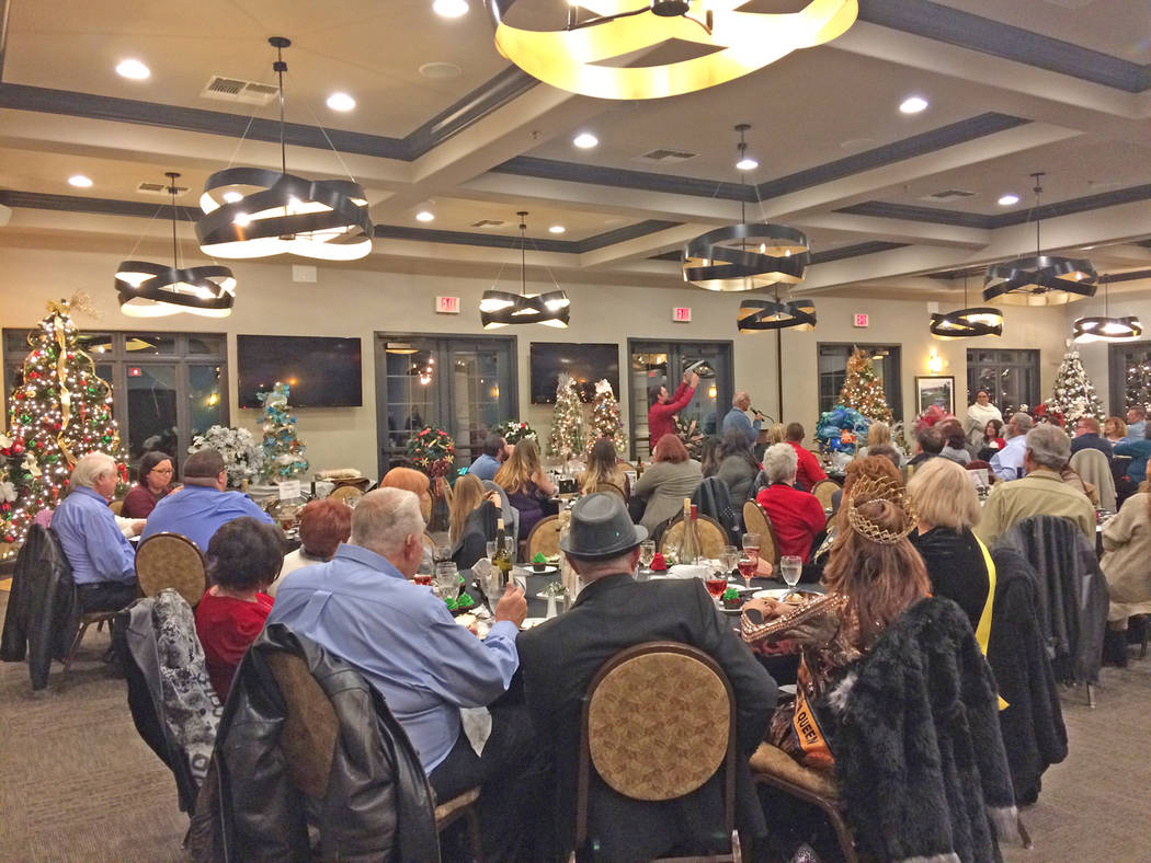 Robin Hebrock/Pahrump Valley Times A large crowd gathered for the 14th Annual Festival of Trees, hosted Dec. 7. In the background, auctioneers Ski Censke and Ron Gipson start off the fun with some ...