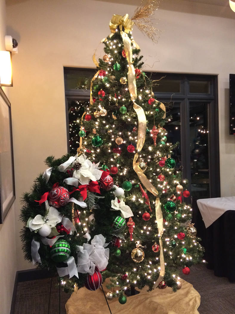 Robin Hebrock/Pahrump Valley Times Christmas trees and wreaths adorned with twinkling lights, beautiful baubles and lengths of garland were donated for the Festival of Trees auction, helping bring ...