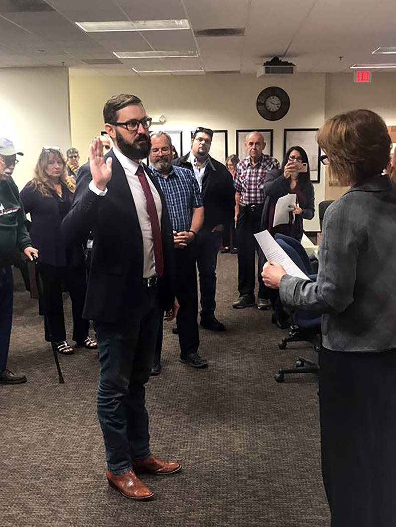 Special to the Pahrump Valley Times Greg Hafen II is pictured taking his oath of office in front of Nye County Clerk Sandra Merlino and officials from Nye, Clark and Lincoln counties. He was sworn ...