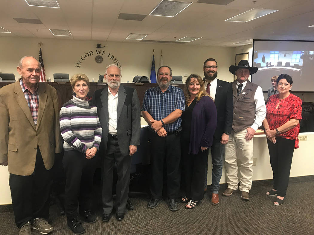 Special to the Pahrump Valley Times Greg Hafen II, third from right, poses for photos with commissioners from Nye, Clark and Lincoln counties following his appointment to the Nevada legislature. P ...