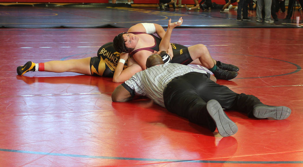 Tom Rysinski/Pahrump Valley Times Pahrump Valley sophomore Anthony Pearson closes in on an 18-second pin of Kamila Montenegro of Bonanza on Saturday at the Liberty Duals in Henderson.