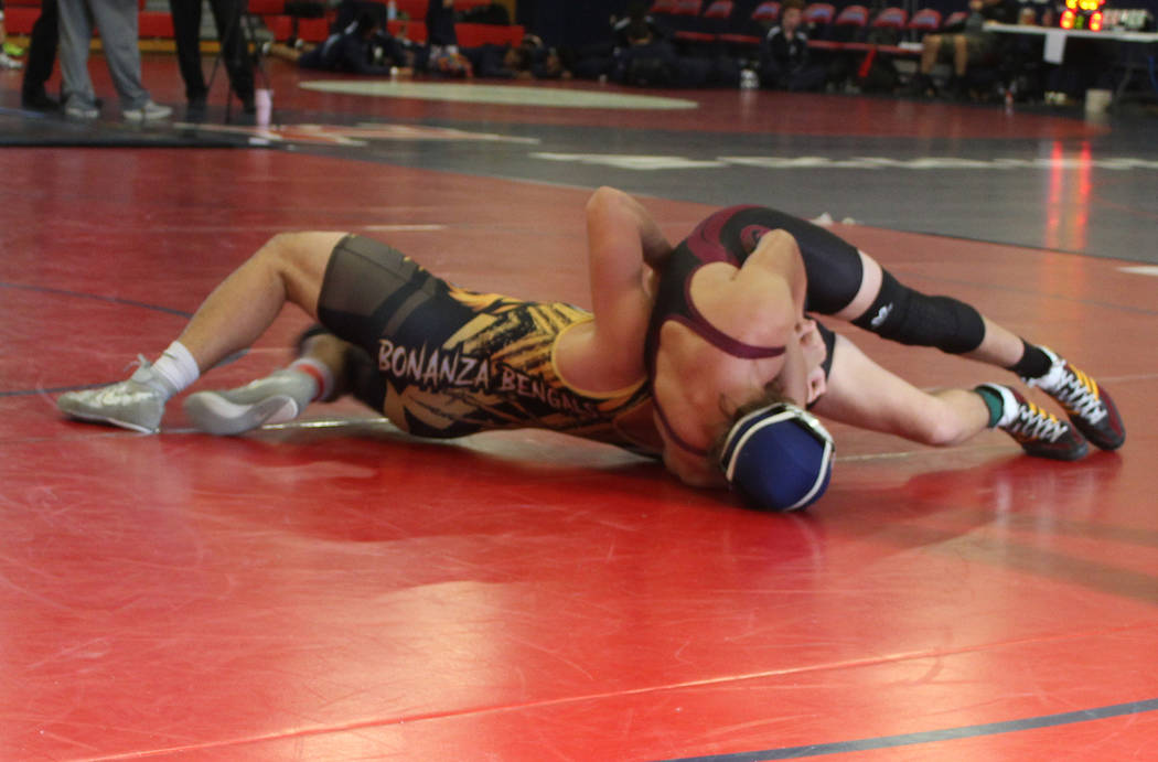 Tom Rysinski/Pahrump Valley Times Sophomore Dylan Wright of Pahrump Valley pinned Bonanza senior Martin Altamirano in 55 seconds during the Trojans' 54-22 win over the Bengals on Saturday in Hende ...