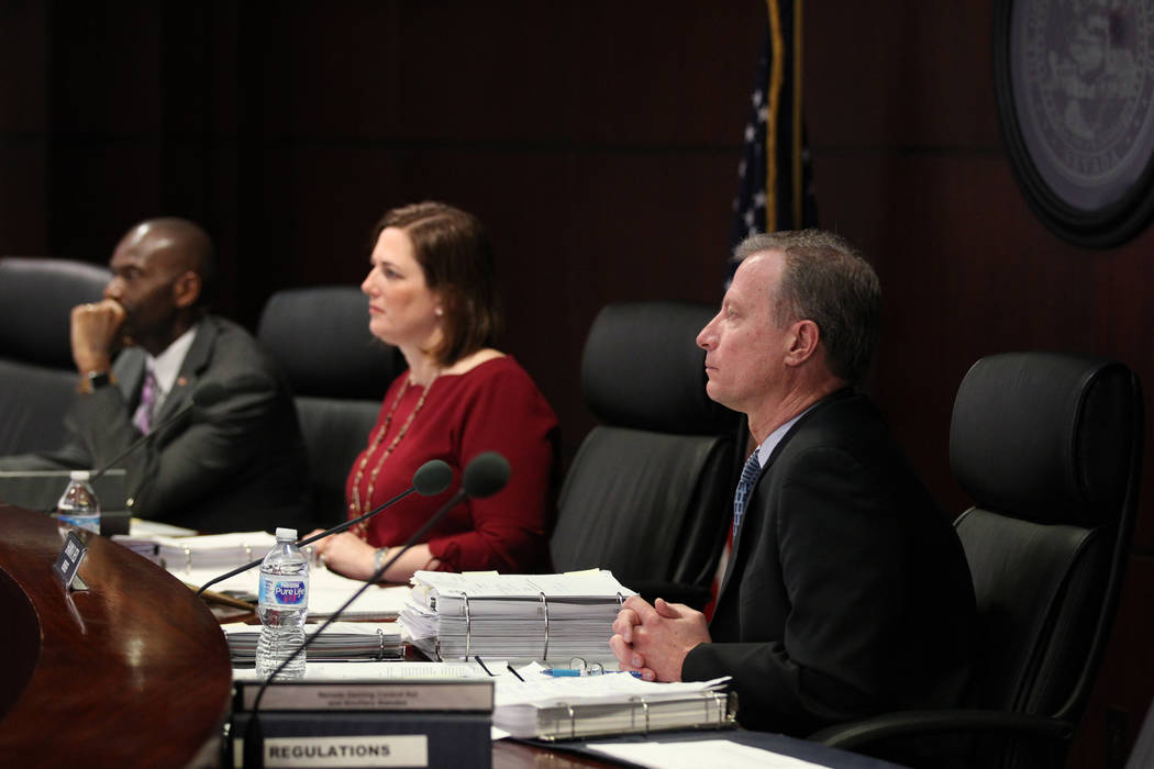 Gaming Control Board members, from left, Terry Johnson, chairwoman Becky Harris and Shawn Reid listen to testimony from Alex Meruelo who was requisition a gaming license transfer for the SLS in th ...