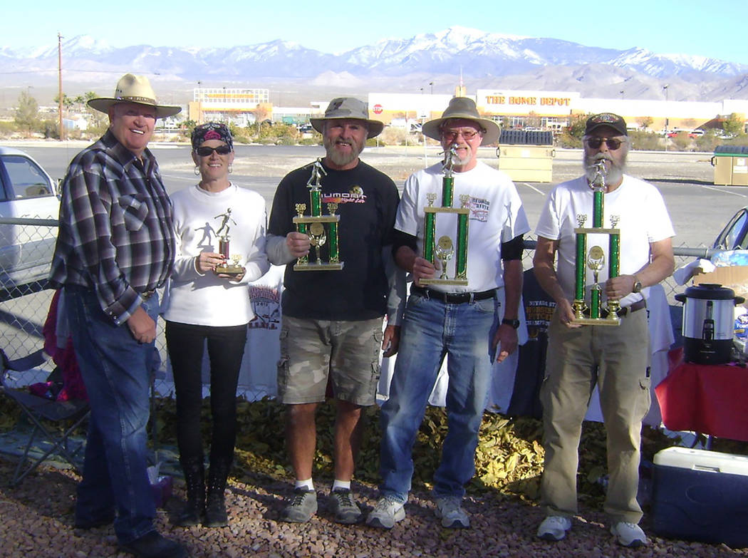 Mike Norton/Special to the Pahrump Valley Times Christmas Open tournament host Dennis Anderson, left, presents trophies to, from right, tournament champion Larry Fellows, B Division champion Don B ...