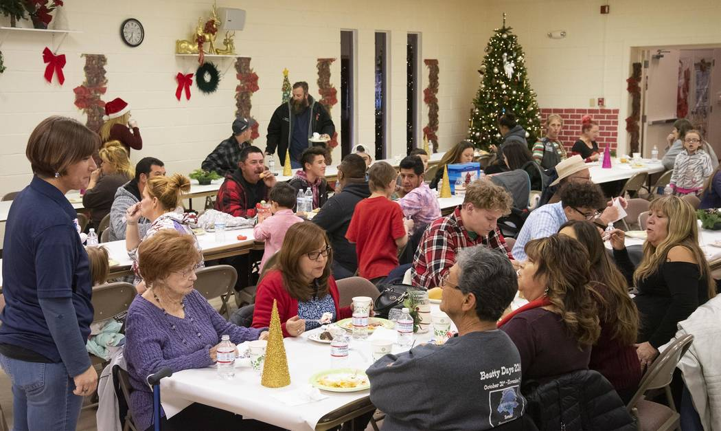 Richard Stephens/Special to the Pahrump Valley Times Local residents enjoyed the Beatty Community Christmas Potluck Dinner with all the traditional dishes at the community center.