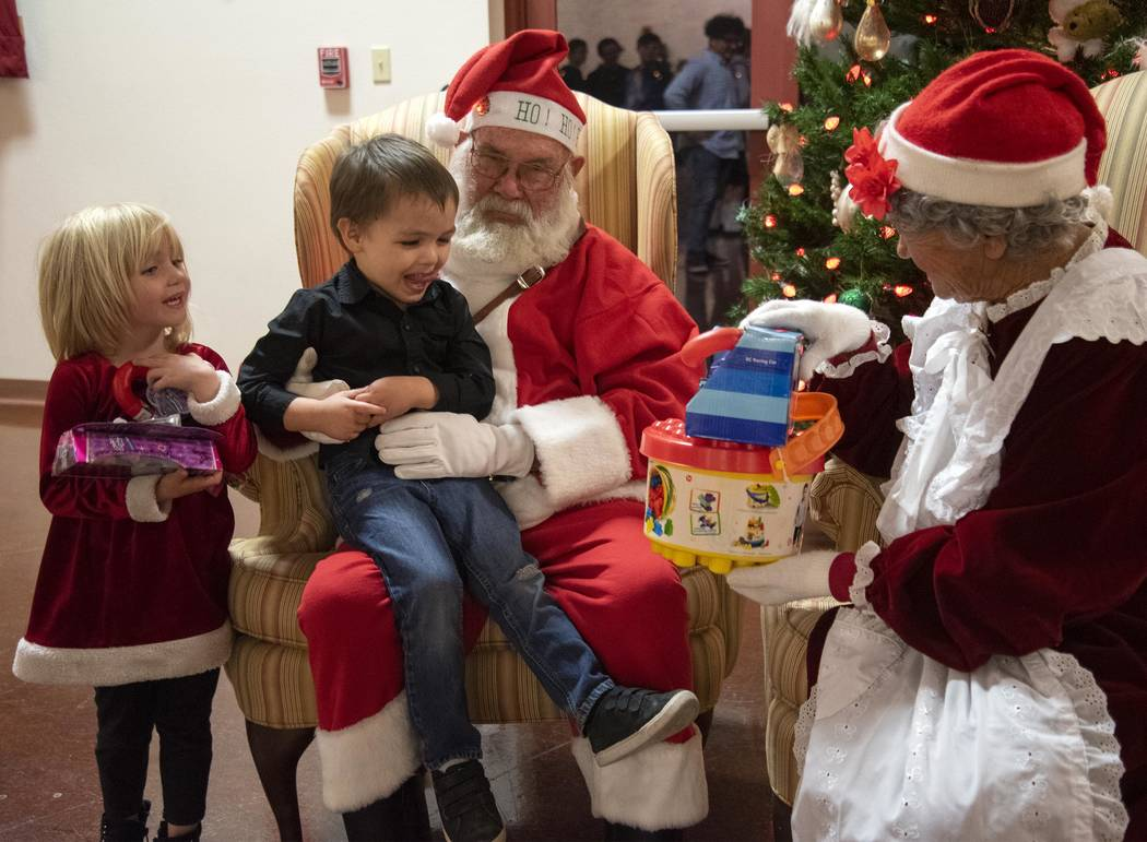 Richard Stephens/Special to the Pahrump Valley Times At Santa Night at the Beatty Community Center, which is sponsored by the Beatty Volunteer Fire Department, Santa and Mrs. Claus passed out gift ...