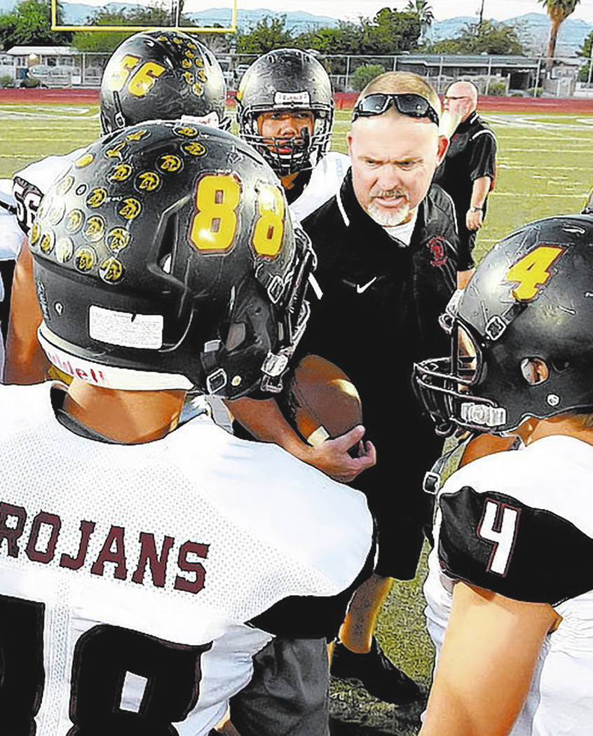 Peter Davis/Special to the Pahrump Valley Times Pahrump Valley football players gather around coach Joe Clayton for a pregame talk before taking on Democracy Prep on Sept. 21 at Rancho High School ...