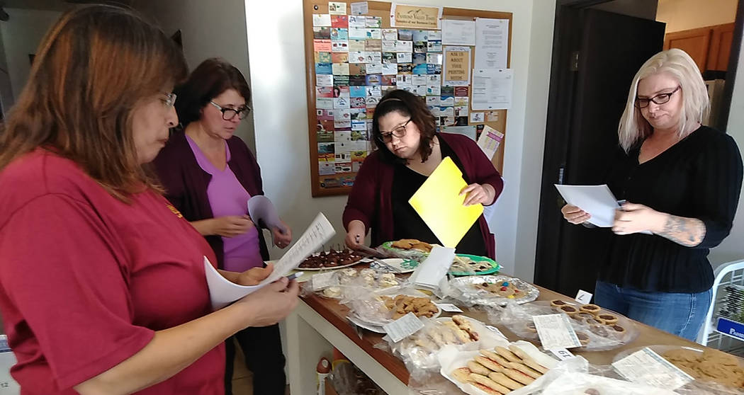 Selwyn Harris/Pahrump Valley Times Pahrump Valley Times staff members take time to judge all 19 entries for the annual Christmas Cookie and Candy Making Contest this month. The top three selection ...