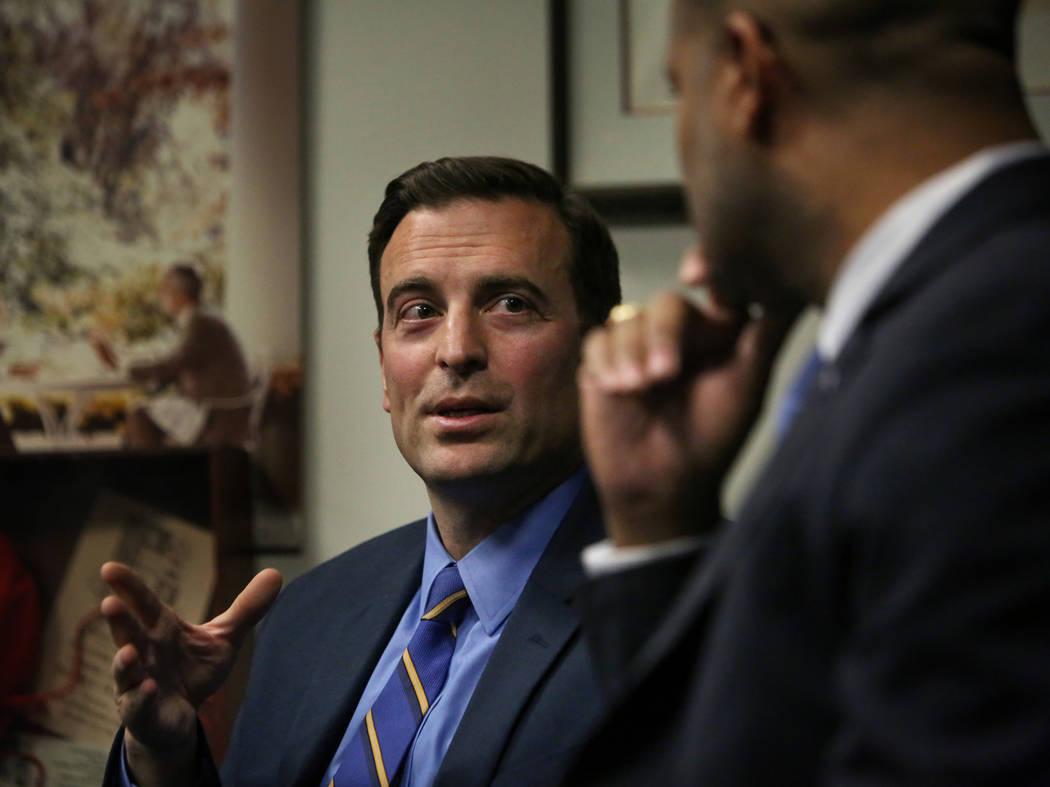 Nevada's outgoing Republican Attorney General Adam Laxalt, left, speaks as his Democratic successor, Aaron Ford, listens during a press briefing in Las Vegas, Monday, Dec. 17, 2018. (Caroline Breh ...
