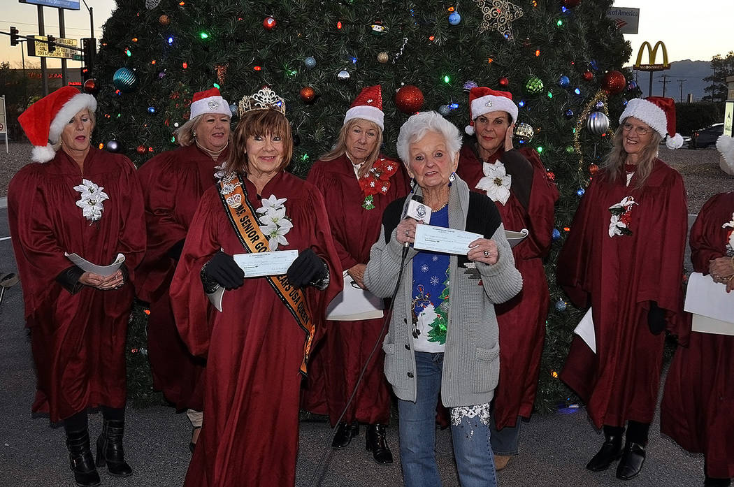 Horace Langford Jr./Pahrump Valley Times Following the 28th Annual Christmas Benefit Show Nevada Silver Tappers and Ms. Senior Golden Years founder B.J. Hetrick-Irwin posed with her ladies before ...