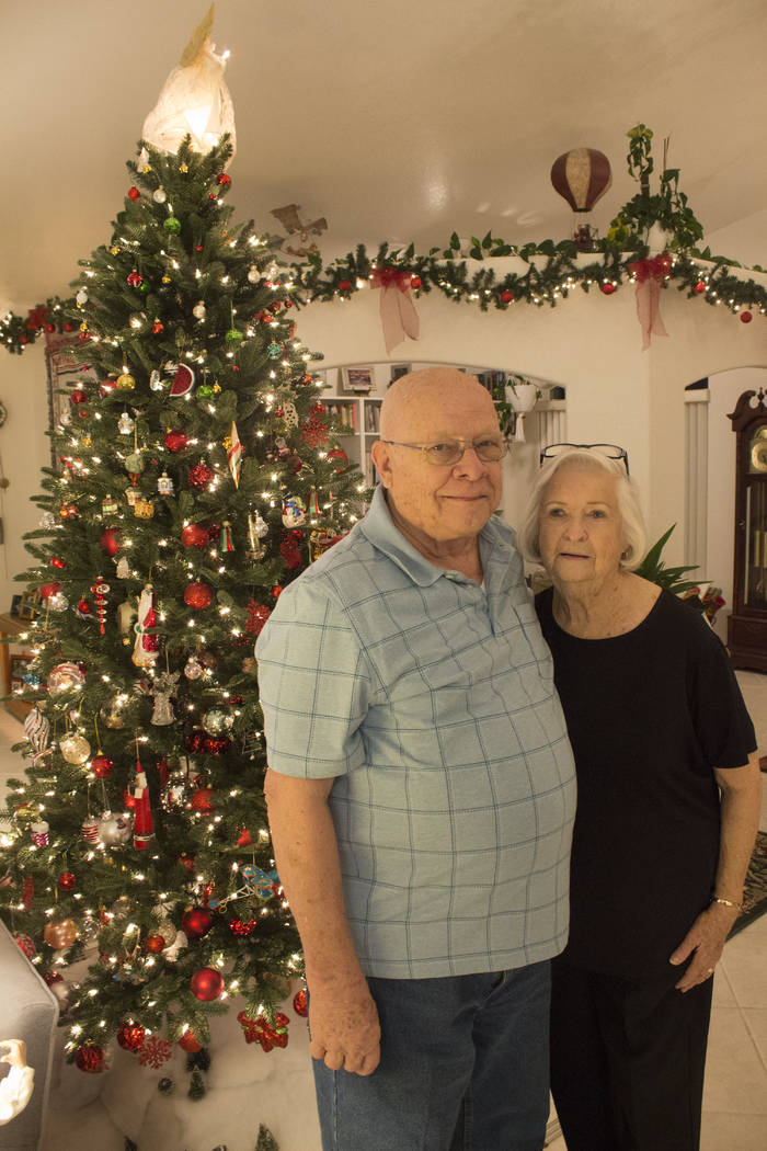 Jeffrey Meehan/Pahrump Valley Times Curt Ahrens (left) stands next to his wife Dot (right) in the living room of their residence that they're opening to individuals and families to view their larg ...