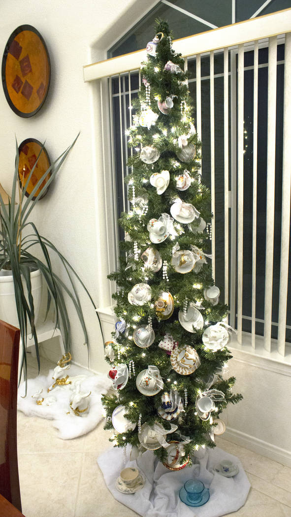 Jeffrey Meehan/Pahrump Valley Times Pahrump husband and wife Curt and Dot Ahrens have more than two dozen individually themed Christmas trees in their local residence. That's just a portion of the ...