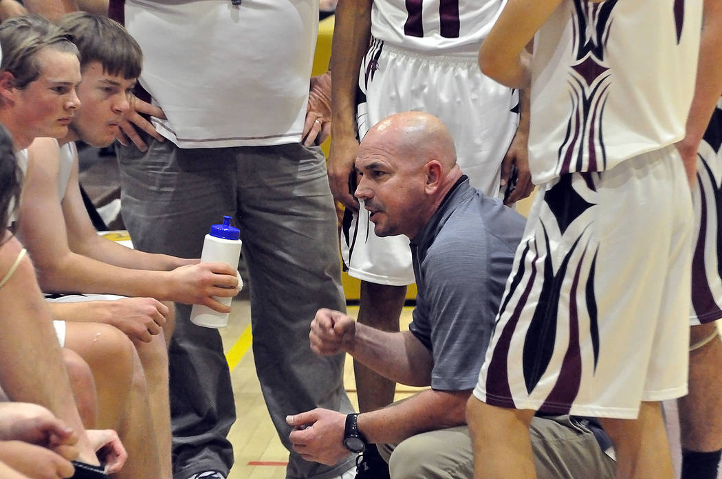 Horace Langford Jr./Pahrump Valley Times Grant Odegard, Koby Lindberg and their teammates gather around Pahrump Valley boys basketball coach Dan Clift during a timeout Friday against Sunrise Mountain.