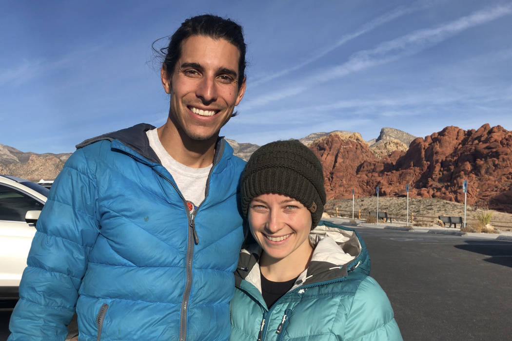Kurt Haston, left, and Amber Wagner, right, get ready to rock climb at Red Rock National Conservation Area, which was accessible despite fee stations being closed on Saturday, Dec. 22, 2018, durin ...
